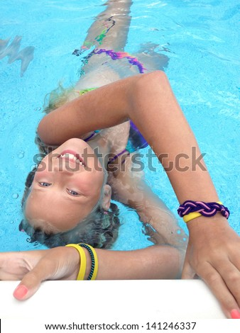 Young girls in swimming pool - stock photo