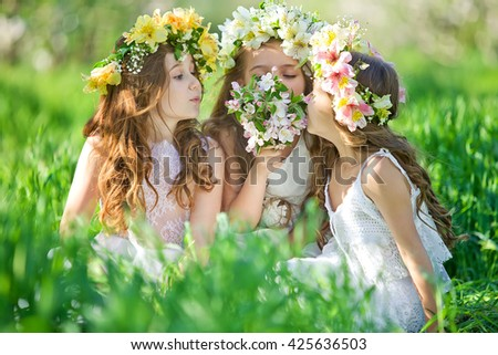 young girls posing in park - stock photo