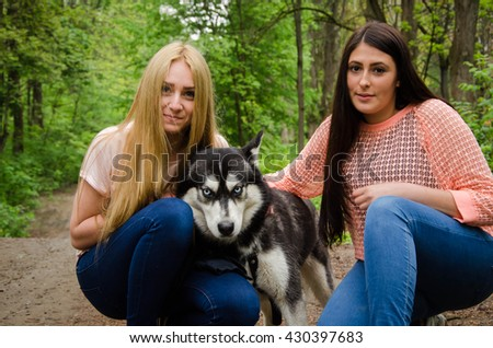 young girls with dog outdoors - stock photo