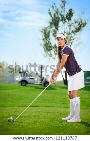 young golfer woman on golf course - stock photo