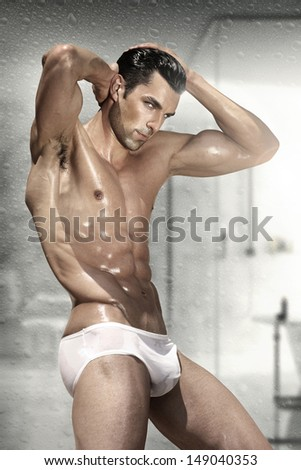 Young good looking and attractive man with muscular wet body - stock photo