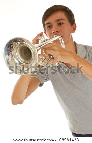 young good looking boy playing the trumpet - stock photo