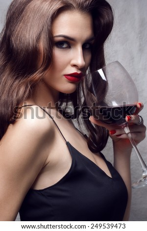 young gorgeous brunette with glass of red wine - stock photo