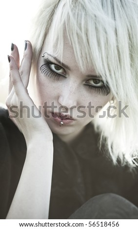 Young goth woman portrait. Soft white colors. - stock photo