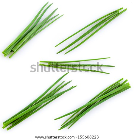 Young green onion set isolated on white - stock photo