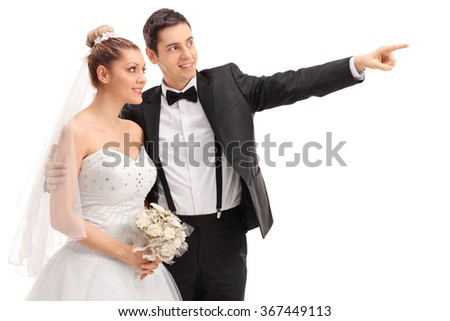 Young groom showing something to his bride and smiling isolated on white background - stock photo