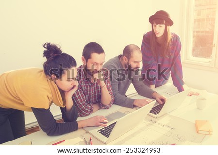 Young group of people/architects discussing business plans. - stock photo