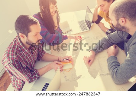 Young group of people discussing business plans. - stock photo