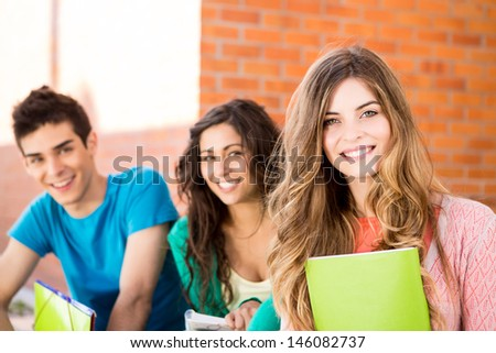 Young group of students in campus - stock photo