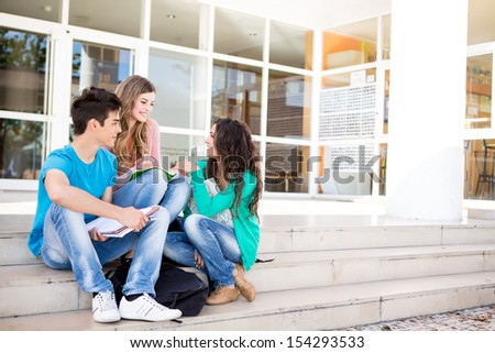Young group of students in school campus - stock photo