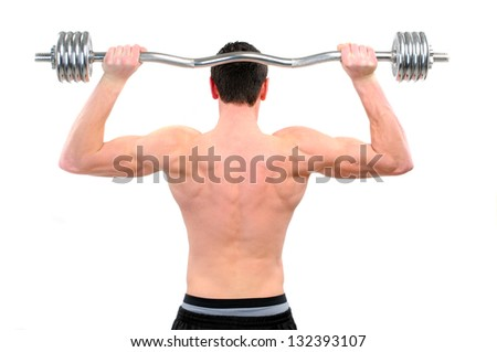 young guy doing exercise with barbell isolated on white - stock photo