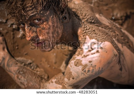 young guy full with mud - stock photo