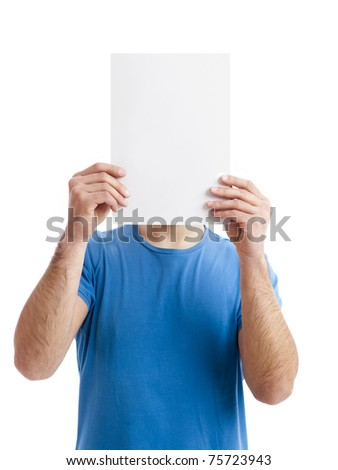 Young guy holding a blank bill board over face isolated on white - stock photo