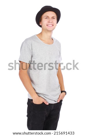 Young guy in a hat and casual t-shirt half length portrait on white background - stock photo