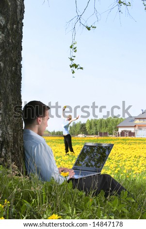 young guy is working outdoors - stock photo