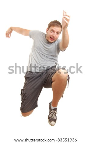 young guy jumping in air, isolated on white - stock photo