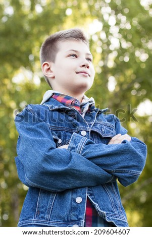 Young guy looking confidently into the distance - stock photo
