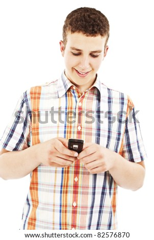 Young guy sending a sms with his mobile phone. All on white background. - stock photo