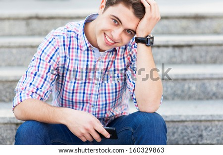 Young guy smiling - stock photo