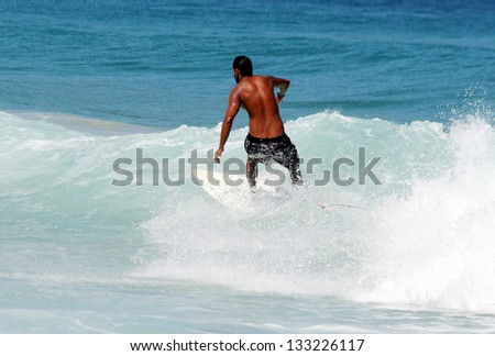 Young guy surfing the wave in Brasil - stock photo