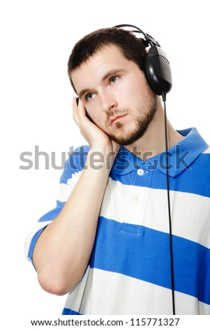 young guy with a beard, headphones, isolated on a white background. - stock photo