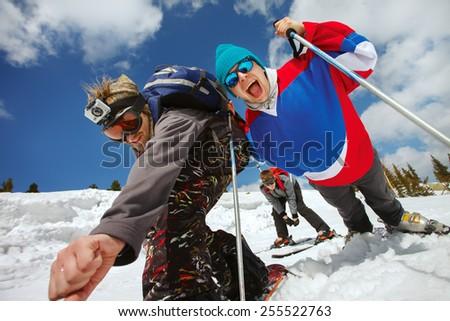 Young guys having fun at ski resort - stock photo