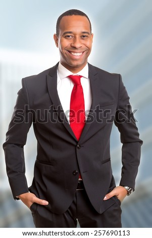 Young handsome african business man posing - stock photo