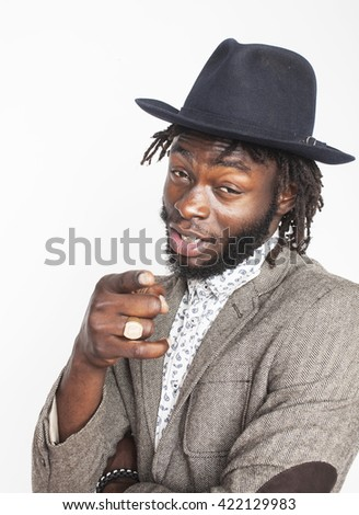 young handsome afro american boy in stylish hipster hat gesturing emotional isolated on white background smiling, lifestyle people concept - stock photo