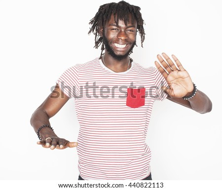 young handsome afro american boy stylish hipster gesturing emotional isolated on white background smiling, lifestyle people concept - stock photo