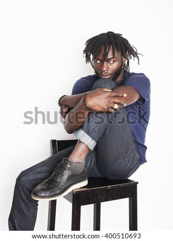 young handsome afro american man, angry look, weed junky isolated on white, problem teenage, depression greef - stock photo