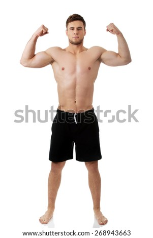 Young handsome athletic man showing his muscles. - stock photo