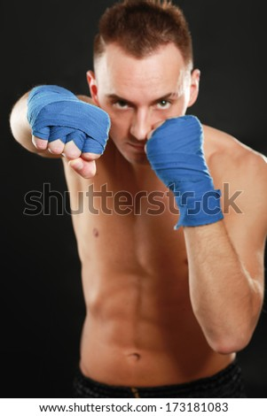 Young handsome boxer man isolated on black background - stock photo