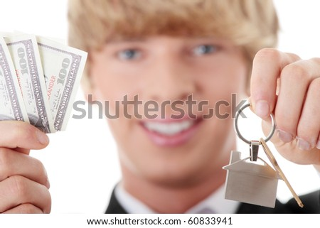 Young handsome business man with house keys- real estate - stock photo