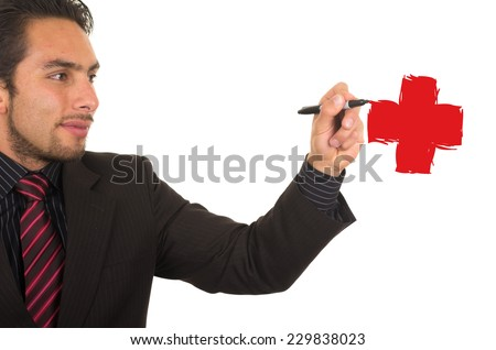 young handsome businessman drawing a red cross on whiteboard with marker concept of health medical insurance investment - stock photo
