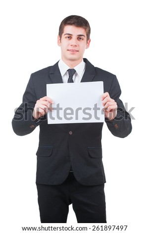 Young handsome businessman holding a blank white paper isolated on white - stock photo