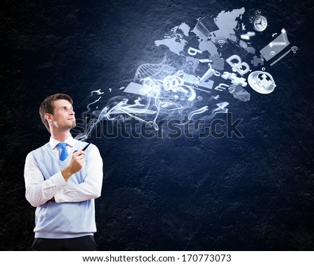 Young handsome businessman in fumes smoking pipe - stock photo