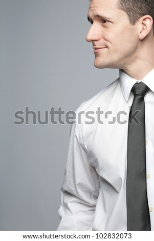 Young handsome businessman in white shirt expressing positivity. - stock photo