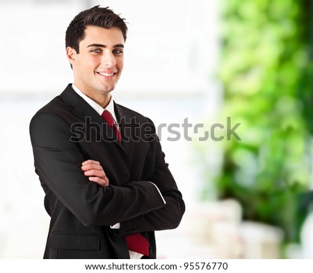 Young handsome businessman with blue eyes portrait - stock photo