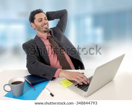 young handsome businessman  working at office computer laptop leaning back on chair relaxed looking happy satisfied and relaxed in business and work success concept - stock photo