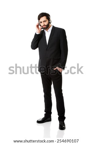 Young handsome call center man talking to customer. - stock photo