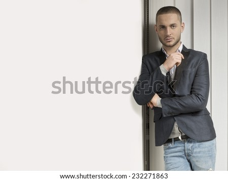 Young handsome caucasian man, blinds background - stock photo