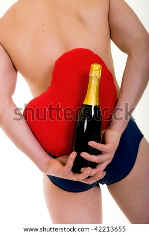 Young handsome gigolo man with valentine heart and champagne bottle,  Studio shot, white background - stock photo