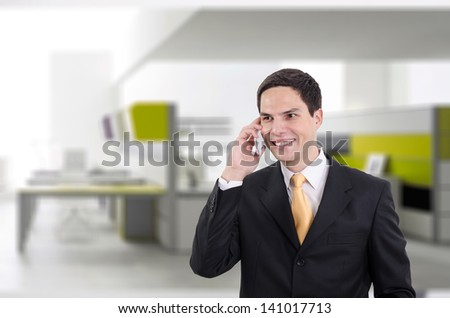 Young handsome guy enjoying a telephonic conversation - stock photo