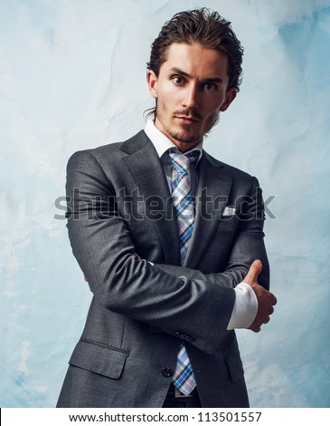 young handsome guy in  stylish suit . photo - stock photo