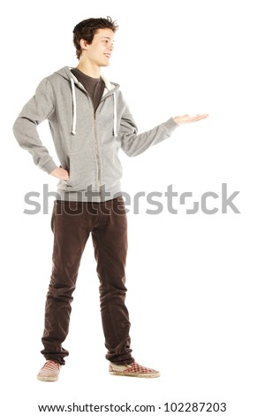 Young handsome happy man with hip style looking to left against white background - stock photo