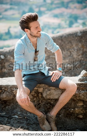 young handsome hipster modern man outdoor in summertime - stock photo