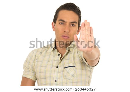 young handsome hispanic man posing gesturing stop isolated on white - stock photo