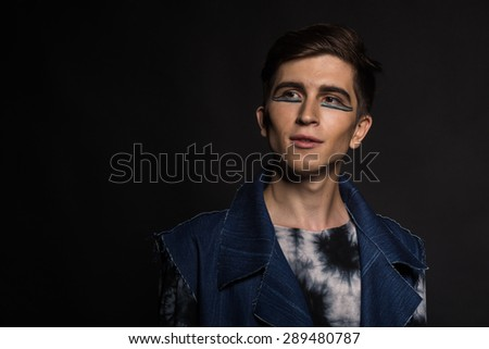 Young, handsome male actor. Actor in theatrical makeup. Emotional game male actor. - stock photo