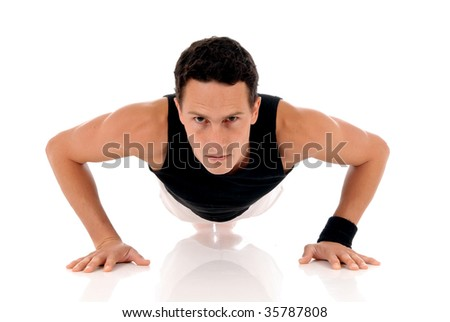 Young handsome male athlete working out, fitness  Studio shot. - stock photo