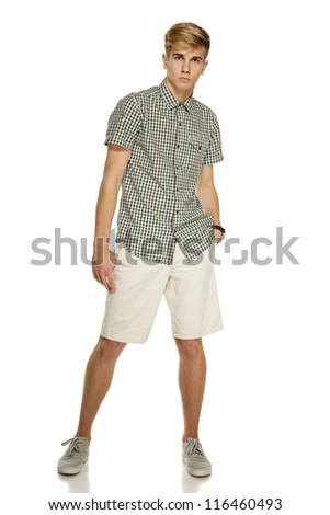 Young handsome male in shorts posing in full length over white background - stock photo